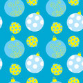 Seamless pattern with Christmas balls on a blue background Royalty Free Stock Photo