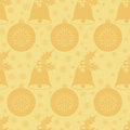 Seamless pattern with Christmas bell with holly leaves and berries, a ball and snowflakes. Flat elements in shades of gold. Vector Royalty Free Stock Photo
