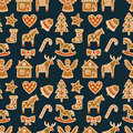 Seamless pattern with Christmas gingerbread cookies - xmas tree, candy cane, angel, bell, sock, gingerbread men, star, heart, deer Royalty Free Stock Photo