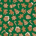 Seamless pattern of christmas homemade gingerbread cookies on green background. Christmas tree, snowflake, deer and snowman. Vecto