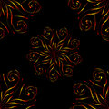Seamless pattern with circular yellow red floral ornament on black background