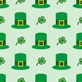 Seamless pattern with clover leaves and bowler hat. Simple vector illustration