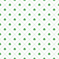 Seamless pattern with clovers leaves and stripes in rhomb shape for design of St. Patricks Day items.