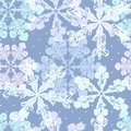 Seamless pattern in cold tones of the snowflakes.