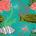 Seamless pattern with collection of sea shell, marine plants, seaweed and tropical fish. Royalty Free Stock Photo