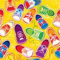 Seamless pattern colored children gumshoes on yellow background Stock Image