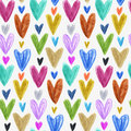 Seamless pattern with colored hand drawn hearts. White backdrop.