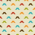 Seamless pattern of colored mustache on striped ba background for textiles interior design for book design website background Royalty Free Stock Images