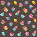Seamless pattern - colorful cakes on a chocolate background