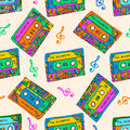 Seamless pattern with colorful cassettes. Hippie style. Doodle musical texture for wrapping, fabric. Vector