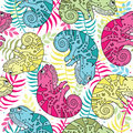 Seamless pattern of colorful chameleons in cartoon style. Bright pattern with chameleons and tropical leaves