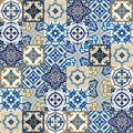 Seamless pattern from colorful floral Moroccan, Portuguese tiles, Azulejo, ornaments. Royalty Free Stock Photo