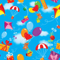 Seamless pattern with colorful gift boxes present presents balloons kite parachute and teddy bears on sky blue background clouds Stock Photo