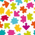 Seamless pattern of colorful jigsaw puzzle pieces. Royalty Free Stock Photo