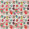 Seamless pattern with colorful owls on cream background.