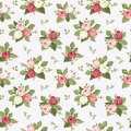 Seamless pattern with colorful rose buds on blue.