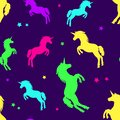 Seamless pattern with colorful silhouette unicorns on purple background. Vector illustration