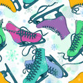 Seamless pattern of colorful skates on a snowflake patterned background Stock Photo