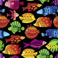 Seamless pattern with colorful tropical fish texture stylized exotic fishes on black background Stock Photography