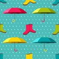 Seamless pattern with colorful umbrellas and rain boots