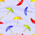 Seamless pattern with colorful umbrellas and raindrops