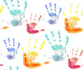 Seamless pattern with colorful watercolor prints of children's hands