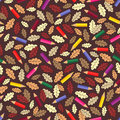 Seamless pattern with colour pencils and autumn leaves