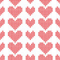 Seamless pattern with cross-stitch hearts on white background. Royalty Free Stock Photo