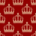Seamless pattern of crowns on a red background Stock Photography
