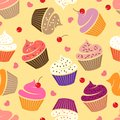 Seamless pattern with cupcakes. Various cakes with hearts and cherries.