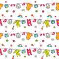 Seamless pattern with cute baby clothes.