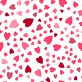 Seamless pattern. Cute background set of hearts in different sizes and colors on a white background.