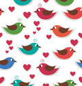 Seamless pattern with cute birds and hearts isolated on white Royalty Free Stock Photo