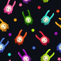 Seamless pattern with cute cartoon colorful aliens.