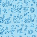Seamless pattern with cute cartoon snails on blue background. Funny animals and plants wallpaper. Doodle floral print. Royalty Free Stock Photo