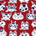 Seamless pattern with cute cats heads emoticons.