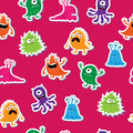 Seamless pattern with cute funny colorful monsters