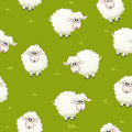 Seamless pattern with cute funny herd white sheeps on grass