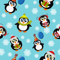 Seamless pattern with cute penguins and snowflakes