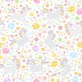 Seamless pattern with cute unicorns and colorful flowers on white background. Vector illustration
