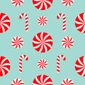 Seamless Pattern Decoration. Christmas Candy Cane Round white and red sweet set. Wrapping paper, textile template. Blue background