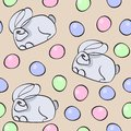 Seamless pattern dedicated to Easter with the image of rabbits and painted eggs. Colorful illustration.