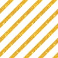 Seamless pattern with diagonal stripes of golden glitter on white background