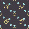 Seamless pattern with diamonds and luxury golden rings. Royalty Free Stock Photo