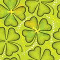 Seamless pattern with dotted four leaf clover on the green background with blots. Traditional symbol of St. Patrick Day. Royalty Free Stock Photo