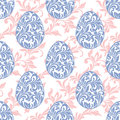 Seamless pattern. Easter eggs with floral elements on a white ba