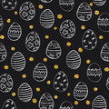 Seamless pattern with Easter hand drawn eggs and golden tinse on black background. Vector illustration.