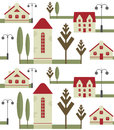 Seamless pattern element of houses with red roofs, street lamps and trees.