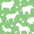 Seamless pattern with farm animals silhouettes over green Stock Photos