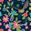 Seamless pattern of flowers with leaves, birds, butterflies on dark blue
